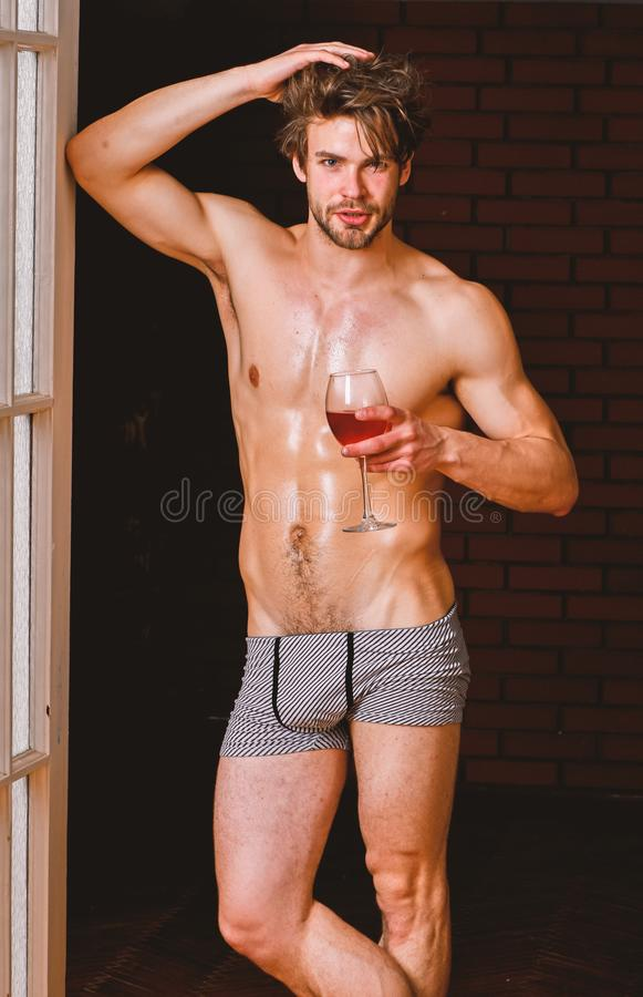 Bachelor sexy body. Sexy attractive macho tousled hair coming out through bedroom door. Sexy lover concept. Guy smooth. Skin posing seductive. Beginning great royalty free stock image