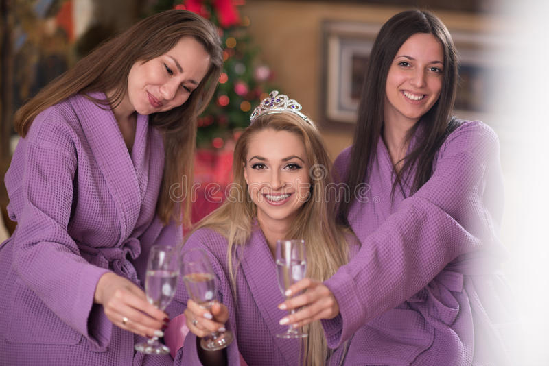 Bachelorette party. Group of famale friends in spa have fun, celebrate bachelorette party stock photography