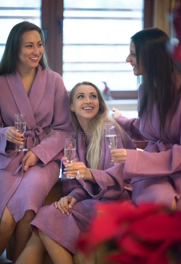 Bachelorette party. Group of famale friends in spa have fun, celebrate bachelorette party royalty free stock photo