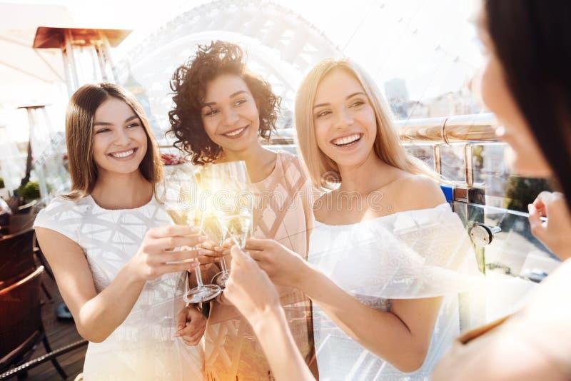 Positive happy women having a celebration stock images