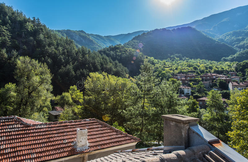 Bachkovo village, Bulgaria. Bachkovo village in Bulgaria, a tradition Bulgarian mountain village located in Rhodopes Mountains with small red traditional stock photography