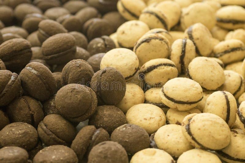 Baci di dama, italian bisquit. With chocolate cream royalty free stock photos