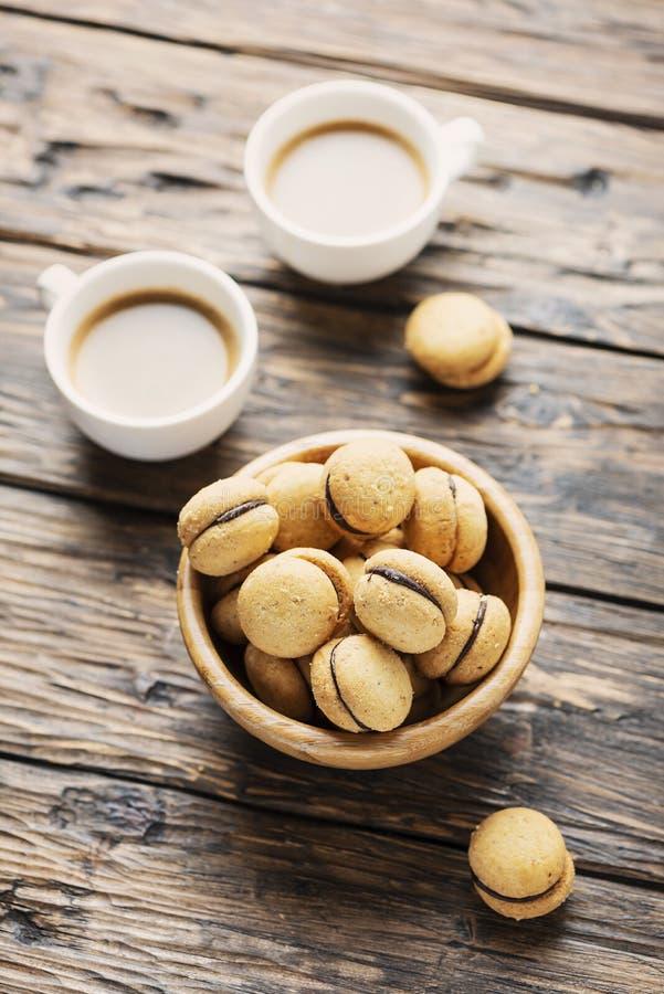 Baci di dama. Italian hazelnut biscuits cookies with chocolate cream, rustic style stock image