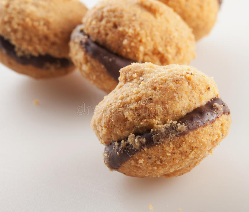 Baci di dama. Typical Italian biscuits, over white background royalty free stock images