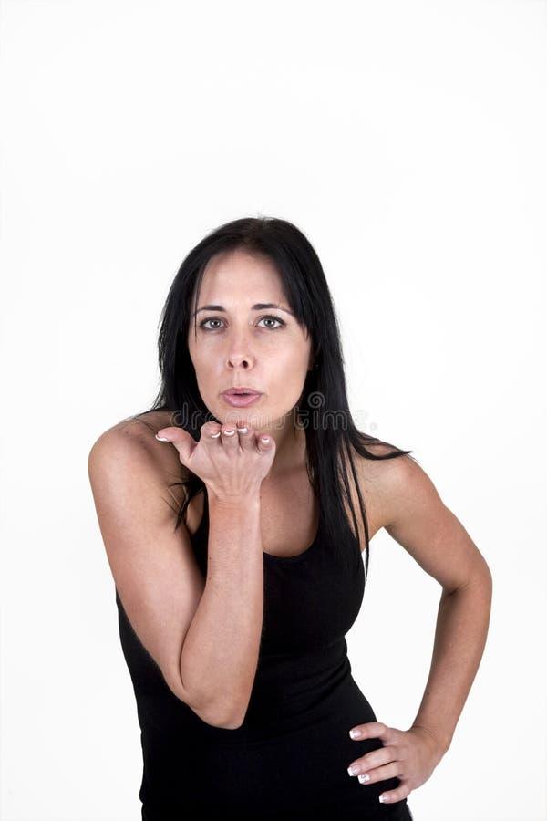 Baci di salto della donna alla macchina fotografica immagini stock