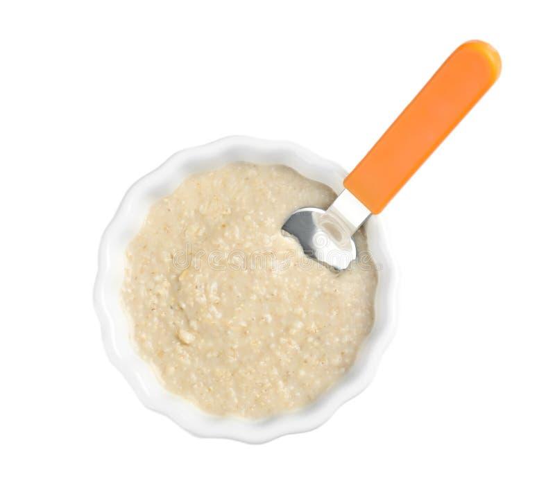 Bacia de comida para bebê saudável no fundo branco fotografia de stock royalty free
