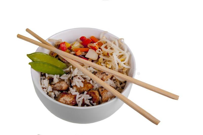 Bacia de refeição e de hashis do arroz selvagem imagens de stock royalty free