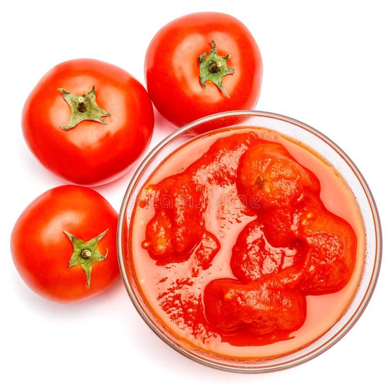 Bacia de vidro pequena do condimento de ketchup vermelha do molho de tomate do peree imagem de stock