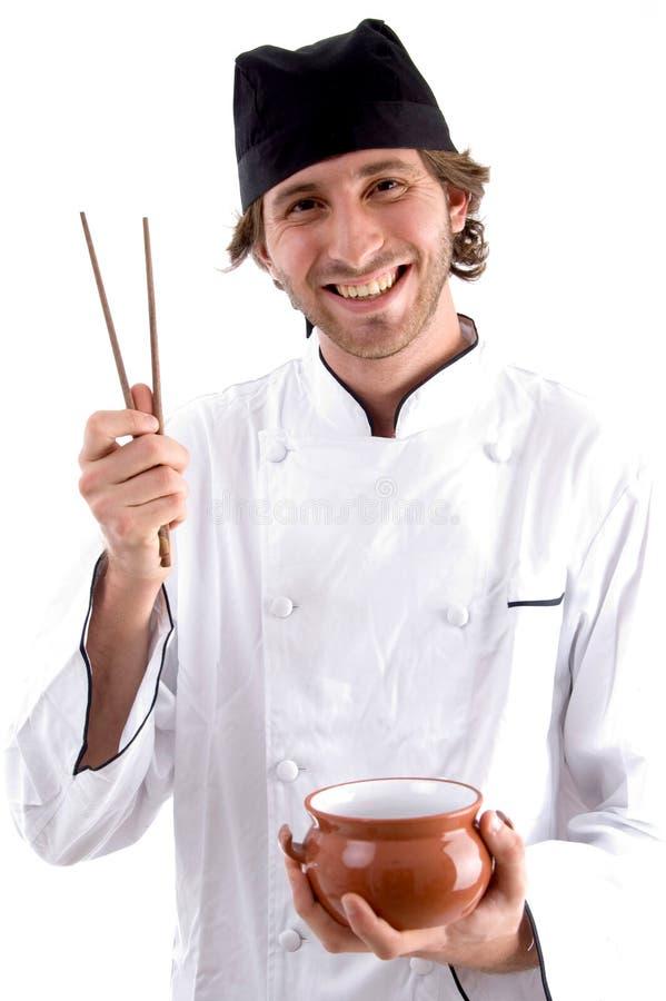 Bacia e chopsticks felizes da terra arrendada do cozinheiro chefe fotos de stock royalty free