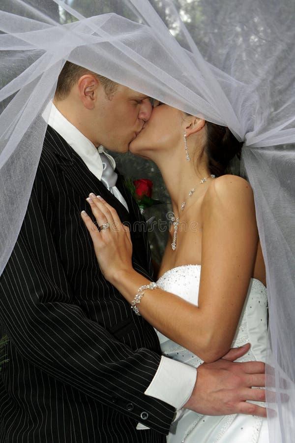 Baciare velare fotografia stock