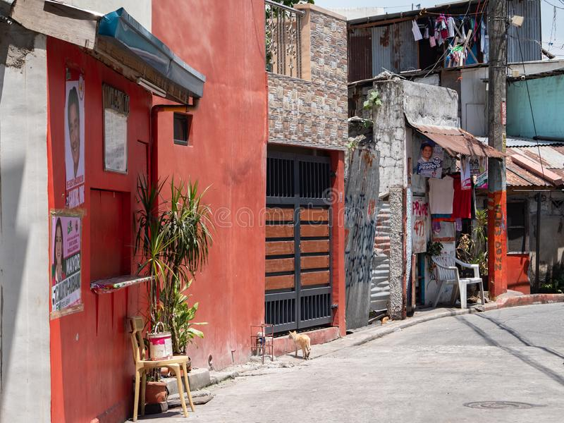 Back alley in downtown Manila. Manila, the Philippines - March 31, 2019: Back alley in the Malate district of downtown Manila. Metropolitan Manila features rich royalty free stock photo