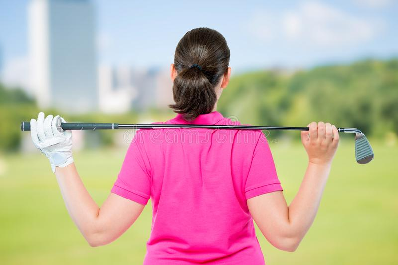 Back is athletes with equipment for playing golf. On a background of golf courses stock image