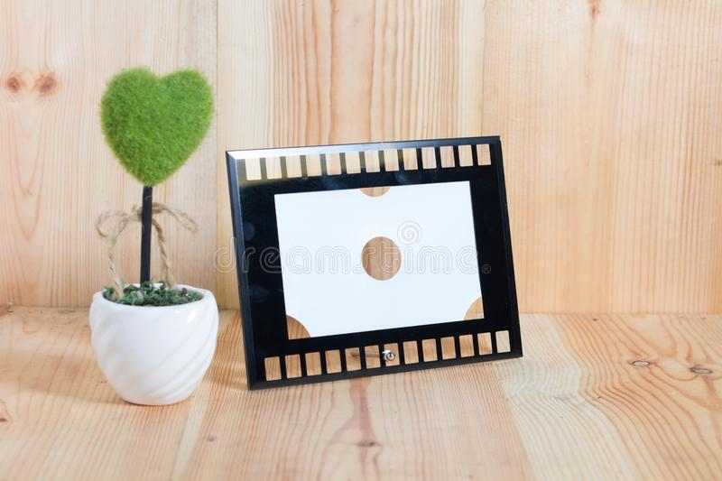 Picture frames on the wooden floor. Back background banner black blackboard blank board chalk chalkboard concept stock photo