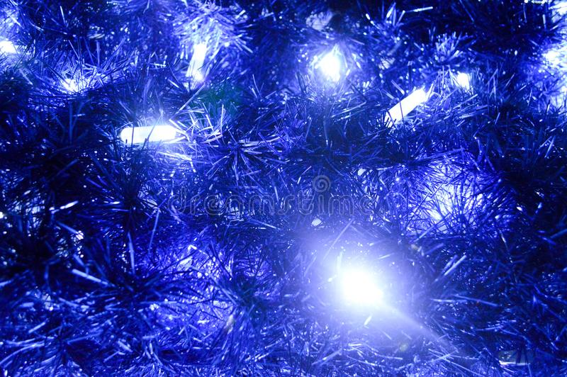 Back background of Christmas decorations, lanterns, lights, garlands, blue rains. New Year`s background royalty free stock photos
