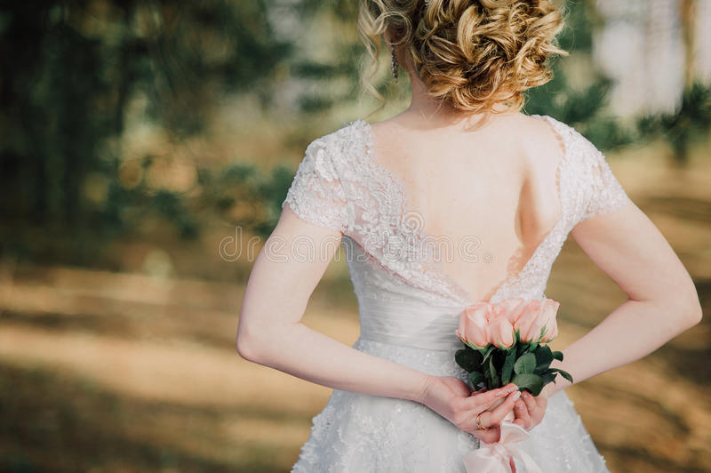 Back of beautiful bride with bridal bunch royalty free stock photography