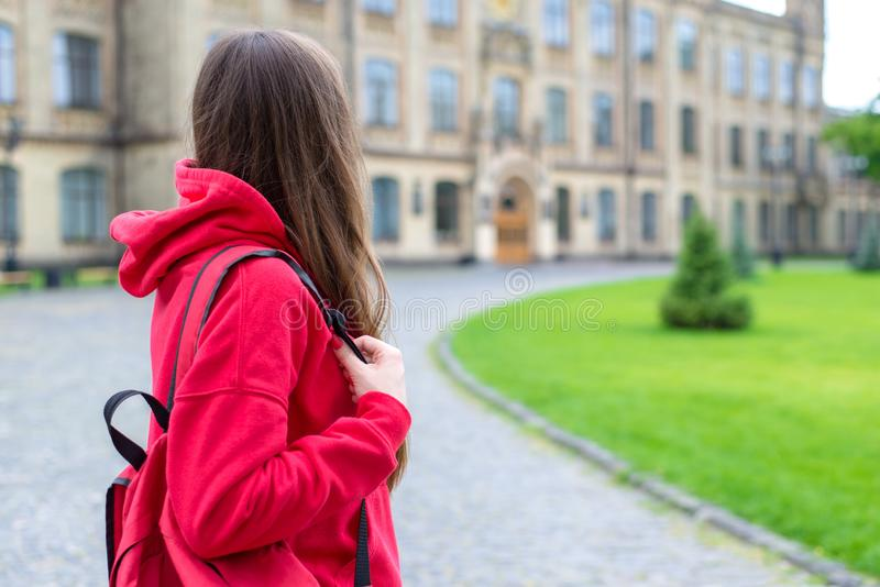 Back behind rear close up view photo of crying depressed stressed workless one lonely hipster looking at the campus doors royalty free stock photo