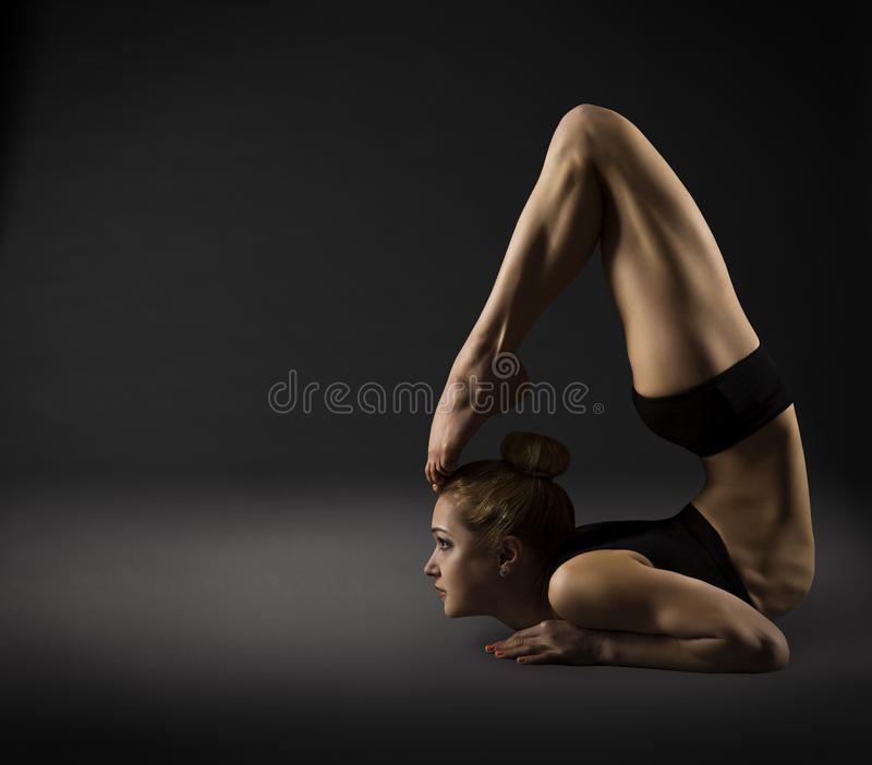 Back Bending, Woman Bowing Stretch Arch, Gymnastics Acrobat. In Backbend Exercising Pose, over dark gray background stock photos