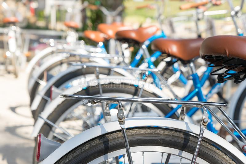 Back of bikes parked in street.  stock images