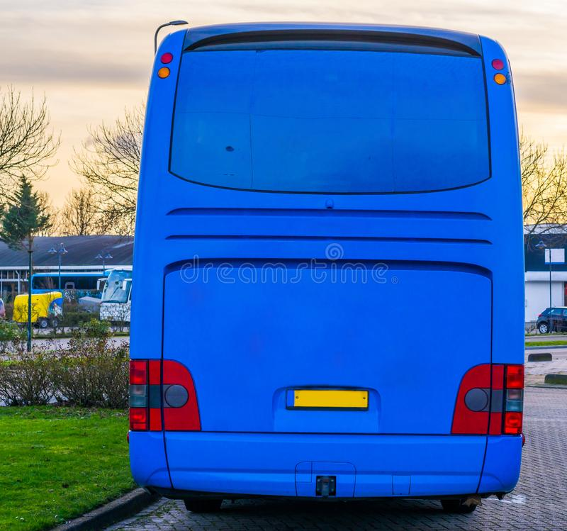 The back of a blue touring bus with a lot of blank space to put whatever you want, travel industry background. The back of a blue touring bus with a lot of blank royalty free stock images