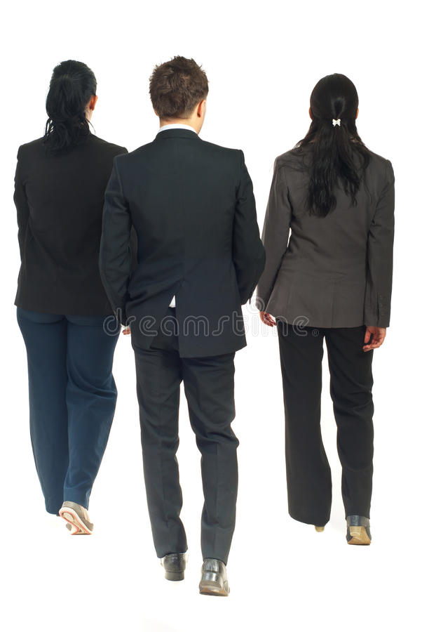 Back of business people walking. Back of three business people walking isolated on white background stock image