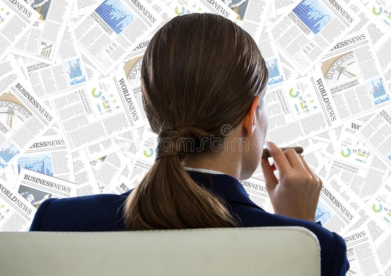 Back of business woman in chair looking at document backdrop. Digital composite of Back of business woman in chair looking at document backdrop royalty free stock photo