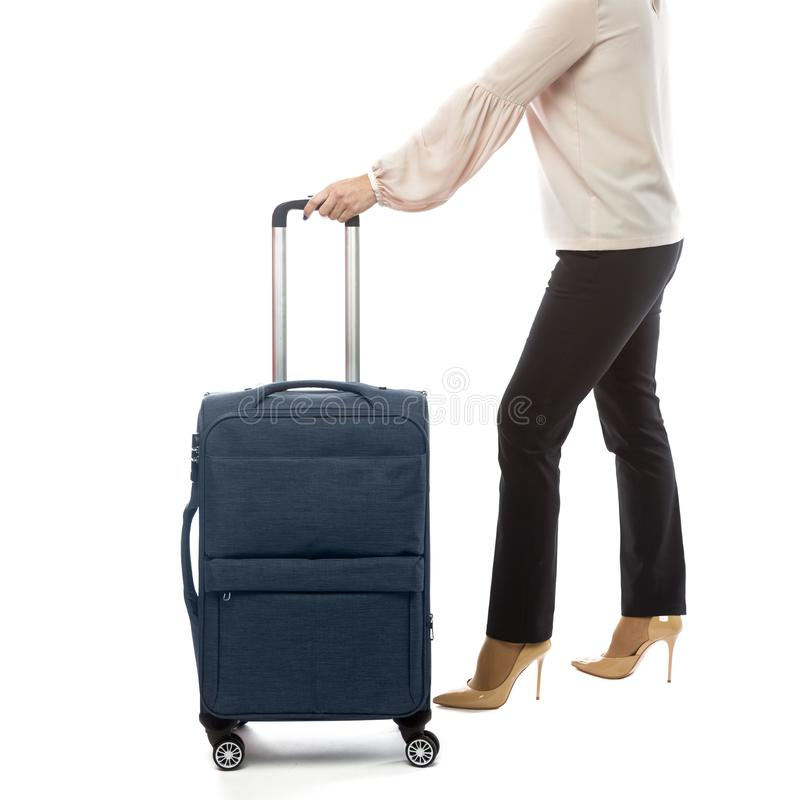 Back of businesswoman going in a travel and carry luggage isolated on white background. Image, suitcase, bag, full, young, people, length, airport, tourist royalty free stock photography