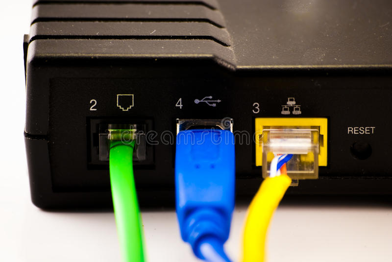 Back of DSL Modem with cables. The rear of a DSL modem with 3 cables isolated on white stock photo