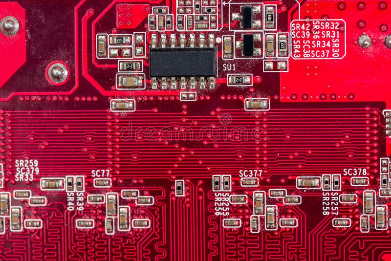 Back side of old red computer motherboard for background. stock image