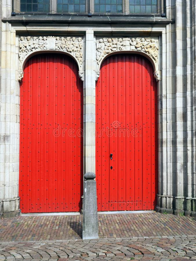 Two red wooden doors of the Buurkerk in Utrecht. Back entrance of the Buurkerk in Utrecht in the center of the city. In this church is museum Speelklok situated royalty free stock photo