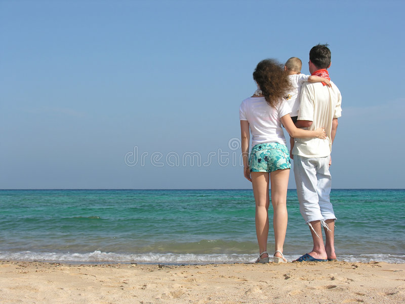Download Back Family Of Three On Beach Stock Photo - Image of people, dressed: 459508