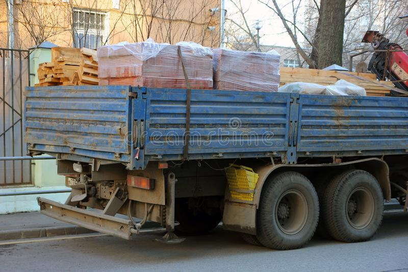 Back of big flatbed truck with side body loaded with building materials royalty free stock image