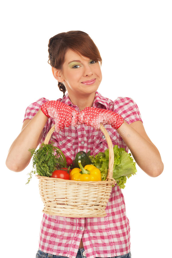 Back from the garden. Young girl is back from the garden with full basket of vegetables stock photos