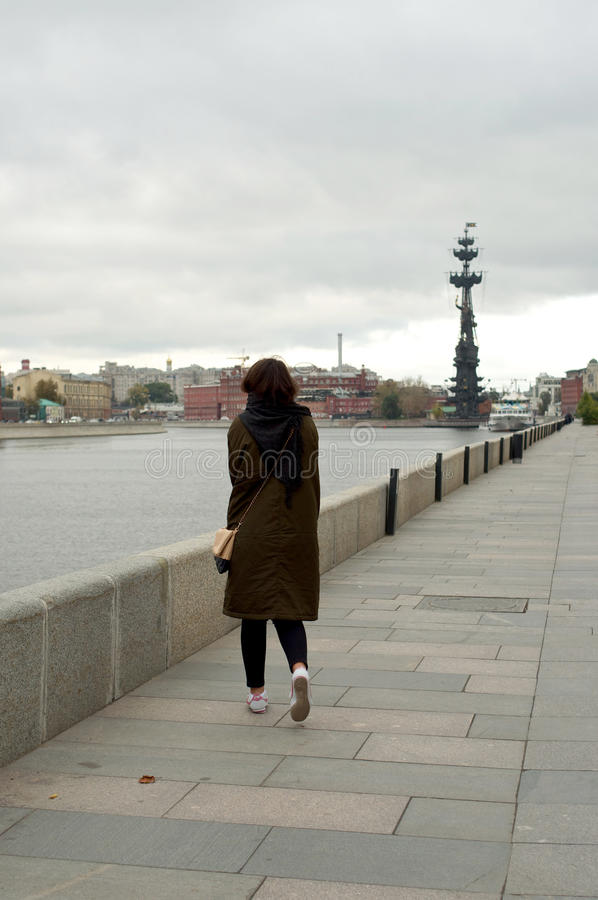 Back of the girl on the bank of Moscow-river stock photography