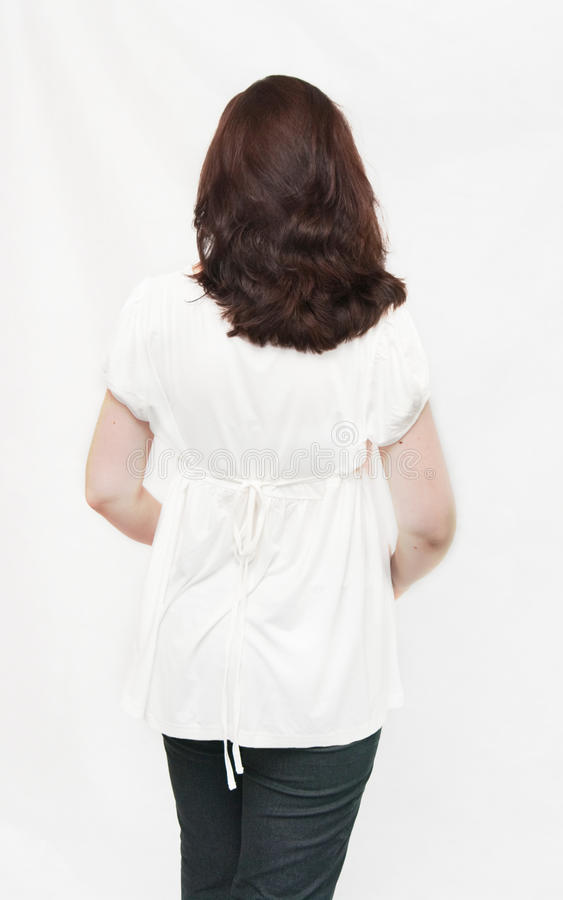 Back of the girl in a white blouse stock image