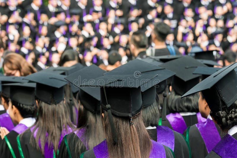Back of graduates during commencement at university. Close up at graduate cap royalty free stock photos