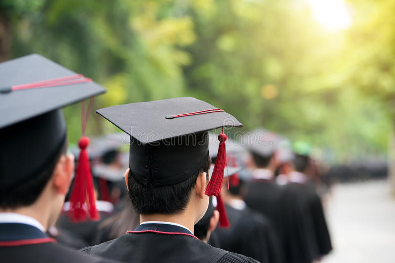 Back of graduates during commencement at university. Close up at. Graduate cap royalty free stock photography