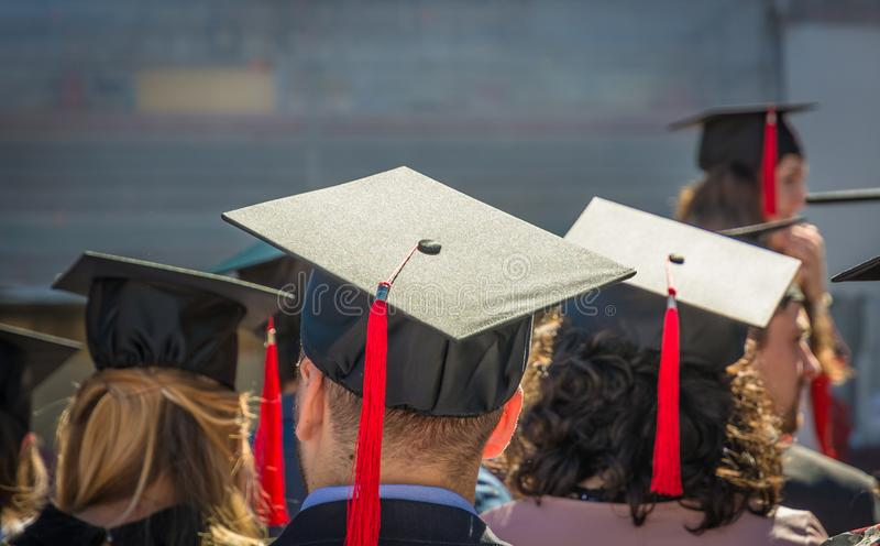 Back of graduates during commencement at university, Close up at graduate cap.graduation ceremony. stock photo