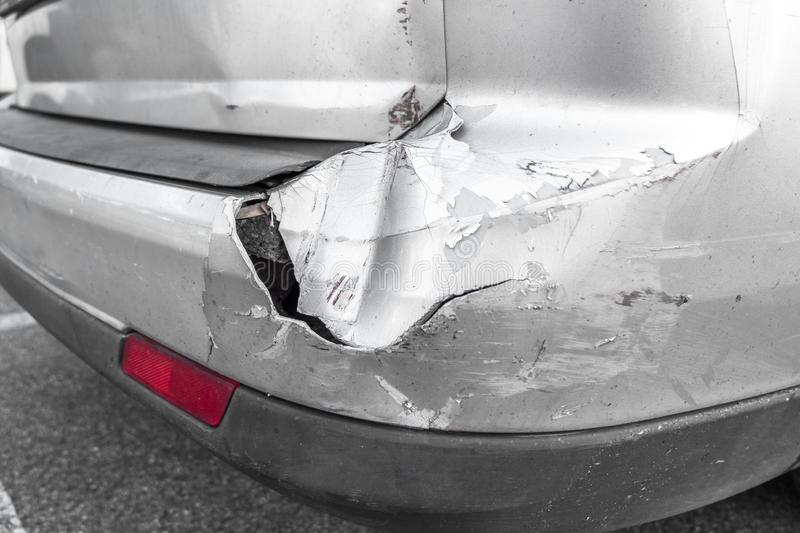 Back of gray car get damaged from accident on the road. Vehicle bumper dent broken by car crash. Road accidents royalty free stock image