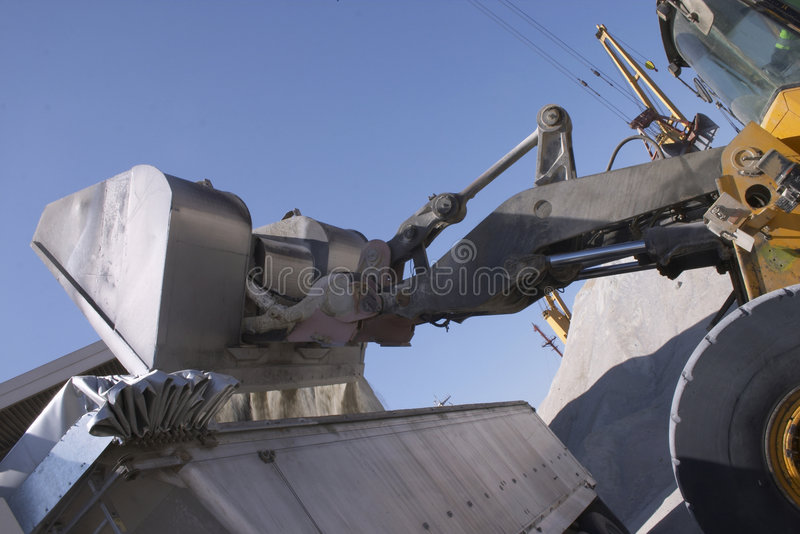 Back Hoe loading a truck royalty free stock photo