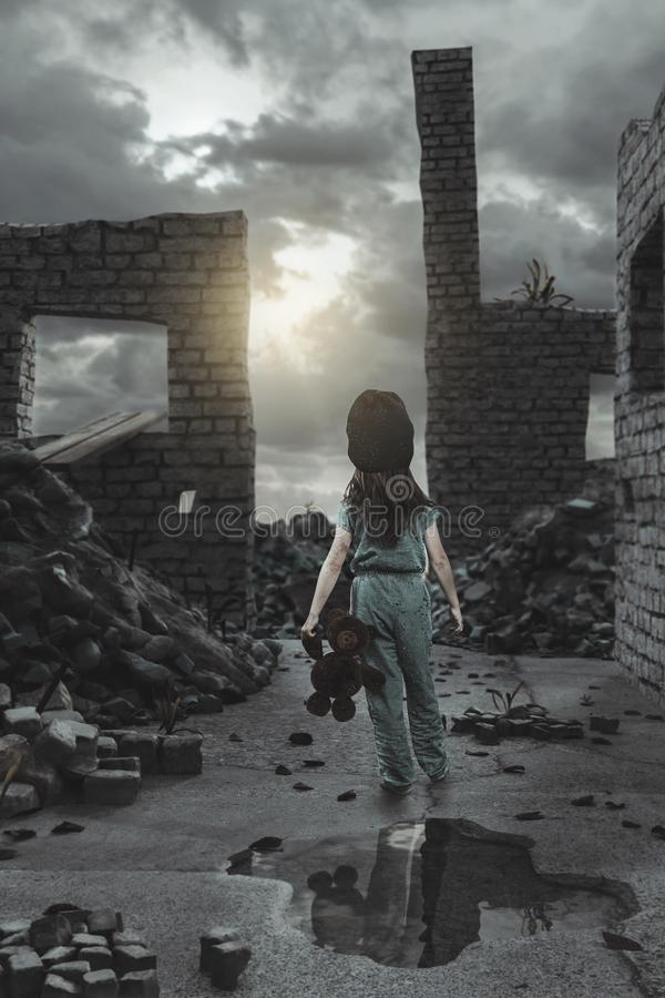 Back of homeless girl with teddy bear in the hand in front of damaged house walls.  royalty free stock image