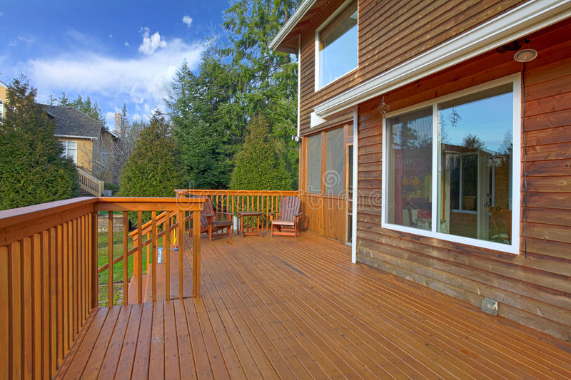 Back of the house with a wooden deck. View of the landscape from the deck royalty free stock photos