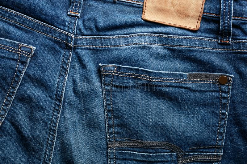 Back of an indigo color blue jean and its pocket stock photos