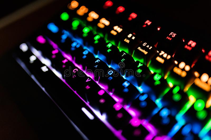 Back lighted computer gaming keyboard with versatile color schemes. stock photos