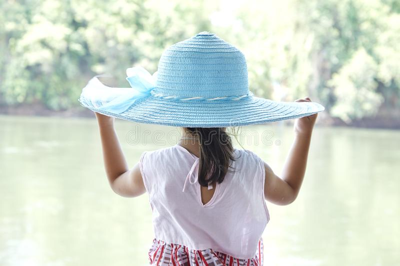 Back Little Asian Girl outdoors in summer stock photography