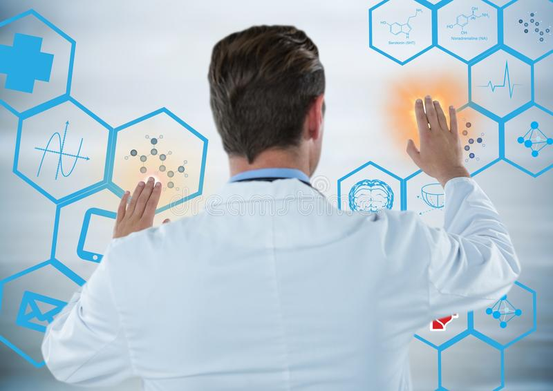 Back of man in lab coat touching blue medical interface with orange flares against grey background royalty free stock photo