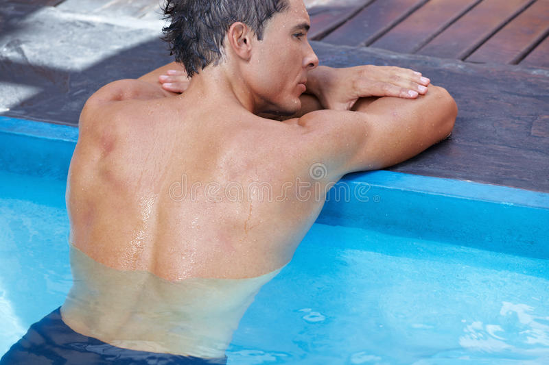 Back of man in swimming pool stock image image of blue recreation 24759561 for Mangalore swimming pool timings