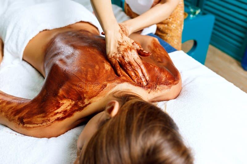 Back massage with chocolate moisturizing mask. stock images