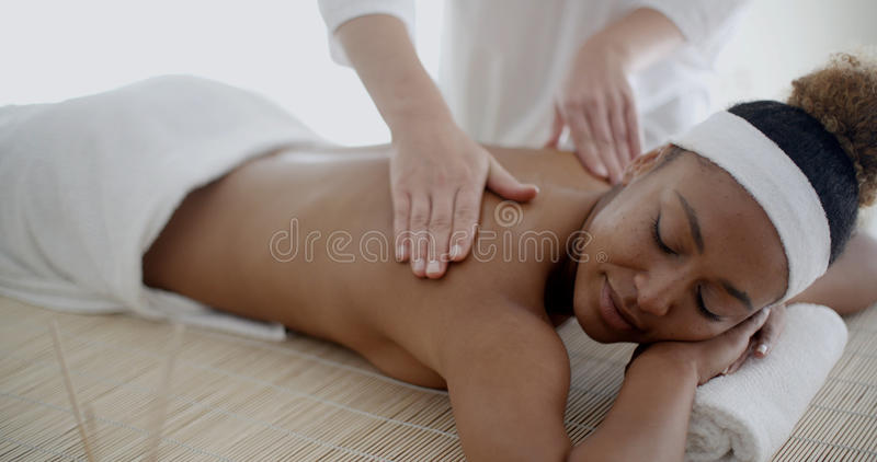 Back Massage On Woman stock images