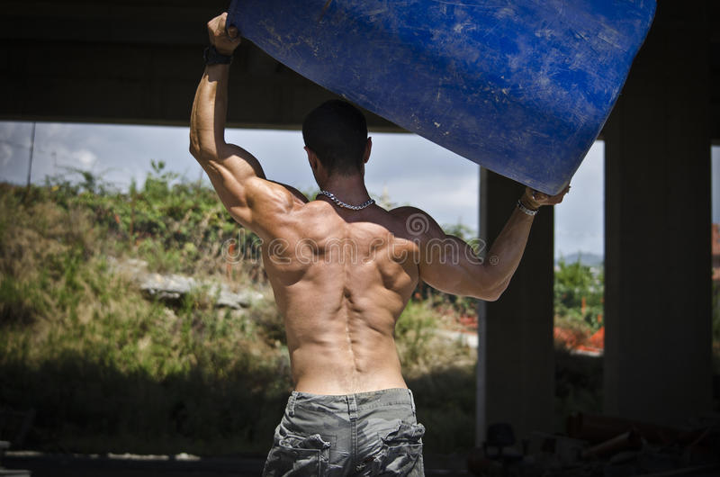 Back of muscular construction worker shirtless stock photo