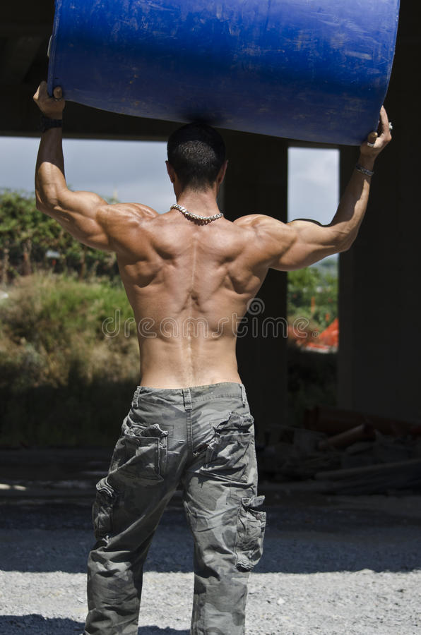 Back of muscular construction worker royalty free stock images